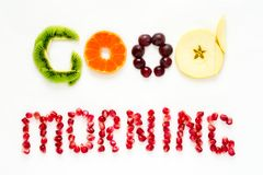 Good morning concept. `Good morning` words laid out with pieces of fruit and pomegranate seeds. Lovely message. Flat lay. Top view. Space for copy Stock Photography