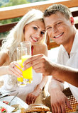 Good morning - couple having juice smiling Royalty Free Stock Photography