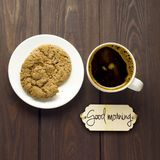 Good morning. Creative concept photo of coffee with cookies on wooden brown background Stock Image