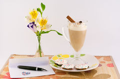 Good Morning. Cup of coffee, flowers, letter, pen, cream and cinnamon on a white background royalty free stock photo