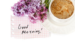 Good morning!. A cup of coffee with milk and Lilac isolated over white. Good morning stock photography