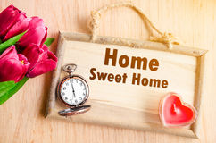 Good morning. Home Sweet Home on house wooden board shape with red tulip flower with red candle heart shape on wooden background stock photos