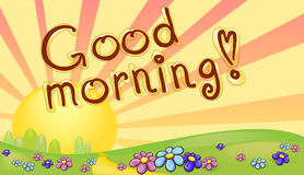 Good morning inscription in a sunrise landscape Stock Photos