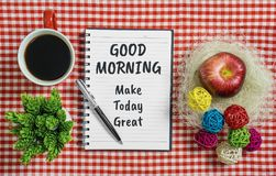Good Morning. Make Today Great in Notebook on Red Napkin. Good Morning. Make Today Great. Notebook with motivational quote on red napkin with pen coffee mug Stock Images