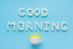 Good morning from marshmallow and coffee cup with rising sun Royalty Free Stock Photography