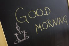 Good morning. Message with coffee cup written on blackboard Stock Images