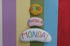 Good Morning Monday, best beginning greet for a great first day of the week with colored stones and rainbow colored wooden board. Unique Good Morning greet with royalty free stock photo