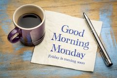 Good Morning Monday, Friday is coming soon. Handwriting on a napkin with a cup of coffee stock photography