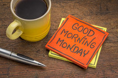 Good morning Monday note with coffee. Good morning Monday - cheerful message on a sticky note with a cup of coffee and pen royalty free stock photo