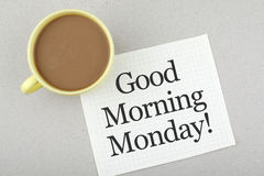 Good Morning Monday Note. Good morning monday message paper with coffee Royalty Free Stock Photo