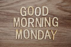 Good Morning Monday text message on wooden background. Top view Good Morning Monday text message on wooden background stock image