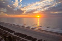 Good Morning Myrtle Beach. Golden sunrise over the beautiful wide sandy beaches of Myrtle Beach, South Carolina royalty free stock image