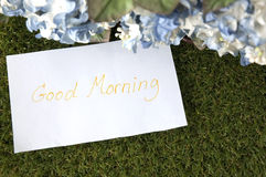 Good morning note with flowers Stock Photo
