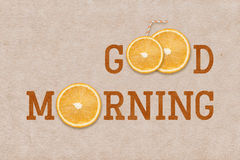 Good morning orange sign. Good morning word printed on vintage paper with orange slices inside Royalty Free Stock Image