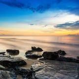 Good morning at rock beach Stock Photos