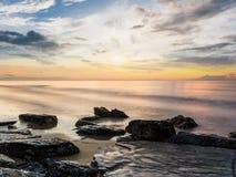 Good morning at rock beach Stock Image
