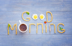Good morning sign. Good morning text by pasta, cup of coffee, eggs and tomato Stock Photos