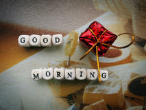 Good morning! - Small wooden cubes and a gift Royalty Free Stock Image