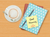 Good morning and smile on blank paper with coffee cup. On wood background Royalty Free Stock Photos