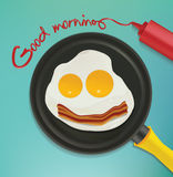 Good morning - smiling face make with frying eggs and bacon. Stock Images