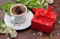 Good morning. Spring. Surprise. Surprise in red box and coffee in white cup, cherry twigs for girlfriend royalty free stock photo