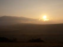 Good morning. Sunrise at 5:10am at Slovakia. Sun came out behind mountain Kriv Stock Photos