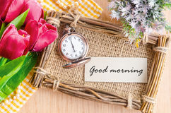Good morning tag on sack photo frame with pocket watch. Stock Photos