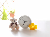 Good morning, teddy. Teddy bear, clock, and flower Royalty Free Stock Images