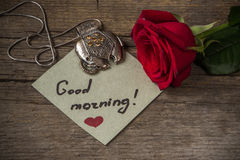 Good morning text on a paper, red rose flower and decoration el Royalty Free Stock Photography