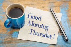Good Morning Thursday. Handwriting on a napkin with a cup of espresso coffee royalty free stock photo