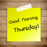 Good morning thursday on sticky paper on Brown wood plank wall t. Exture background with detail Royalty Free Stock Photo