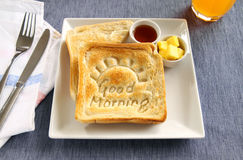 Good Morning Toast. Slice of toast with Good Morning carved into it with butter and honey Royalty Free Stock Photography