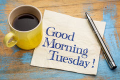 Good Morning Tuesday. Handwriting on a napkin with a cup of espresso coffee Stock Photos