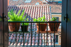 Good morning Vicenza. An open window with a typical balcony of northern Italy and some flowered vases royalty free stock images