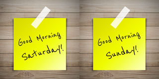 Good morning weekend on sticky paper on Brown wood plank wall te. Xture background Royalty Free Stock Image