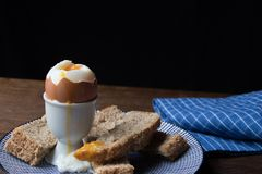 Good morning, what a wonderful start of the day. A deliciously soft boiled egg at breakfast, is a wonderful start of the day, made with love by mom stock image