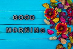 Good morning word on blue wood with flower stock images