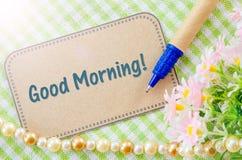 Good morning wording on brown paper. Good morning wording on brown paper with pen on cloth Stock Photos