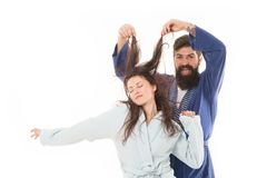 Good morning world. Go from flat to fluffy. happy bearded man play with hair of sleepy girl. family couple in robe. Love. Good morning world. Go from flat to stock images