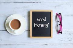 Good morning written on a blackboard. Stock Photos