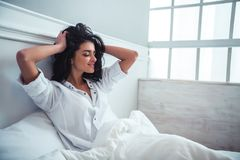 Beautiful girl in bed Royalty Free Stock Image