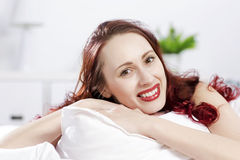 Good morning. Young happy woman lying in bed and smiling Royalty Free Stock Image
