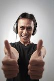 Good music. Double thumb up man listening good music royalty free stock photos