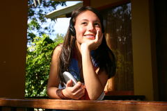 Good music. Teen aoman listening to music at home Royalty Free Stock Photo