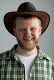 The good-natured cowboy hat. And a green plaid shirt royalty free stock image