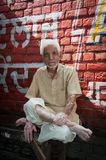 Good-natured senior indian man with cigarette Royalty Free Stock Photography