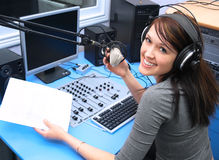 Good news. Radio DJ in the broadcasting studio stock photography