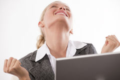 Good news!. Beautiful young businesswoman receiving very good news while working on her laptop Stock Images