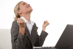 Good news!. Beautiful young businesswoman receiving very good news while working on her laptop Stock Photo