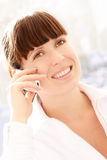 Good news. Young woman with phone, good news Stock Photography